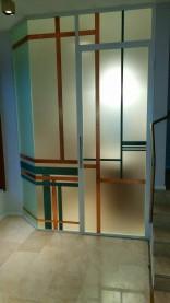 Rivestimento su vetro in rame ossidato e rame naturale con finitura a polvere trasparente